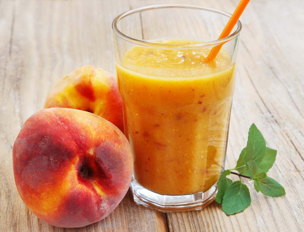 Healthy Delicious Peaches Smoothie in a Glass with Mint Leaves